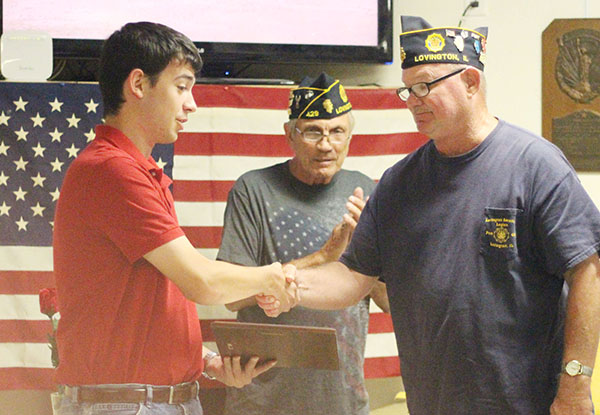 Photo by Darian Hays Lovington American Legion Commander George Clark (right) honors Aaron Fleming for his years of playing Taps for military rites, while Tom Brown Honor Guard coordinator looks on.