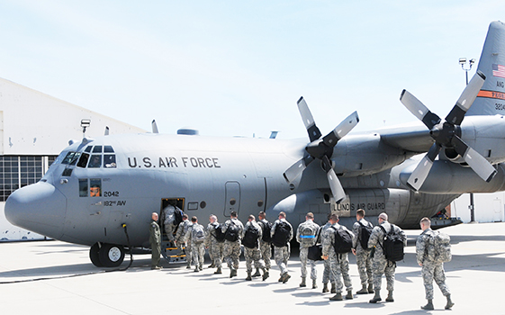 Photo furnished Deploying Airmen of the 183rd Air Operations Group based in Springfield, Illinois, board a C-130 aircraft on the first leg of their journey to duty in the Middle East. Approximately 80 members of the unit will provide command and control of airpower to Air Forces Central Command and are expected to return home in January 2017. (U.S. Air National Guard photo by Master Sgt. Shaun Kerr)