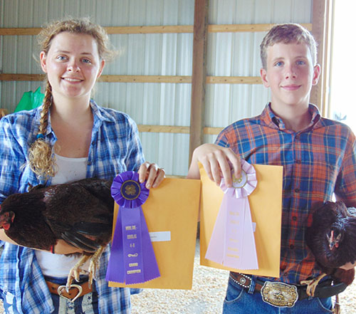 Photo furnished Mo-Do Fair Ribbon Winners Winning ribbons in the Moultrie Douglas Fair 4-H Livestock show were Blair Monroe of Bethany and Ben Bushue of Sullivan.