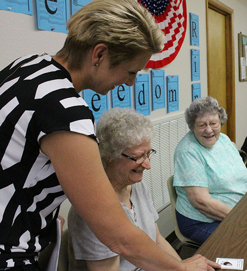 Photo by Mike Brothers Moultrie Douglas Extension educator Cheri Burcham introduces Judy Brown to the first of the Memory Game story cards. Brown had a lion card, and she went to the zoo. Nina Glazebrook had to remember Brown's story while adding her own story to the list as they traveled around the table at Mid-Illinois Senior Center in Sullivan last week.