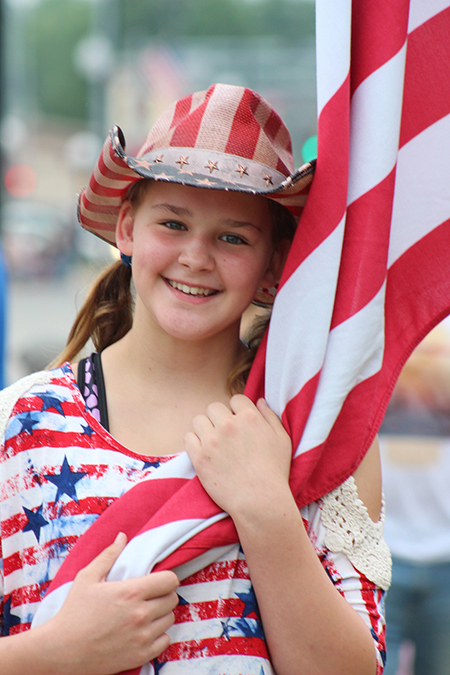 Photo by R.R. Best Salute to Old Glory Lilly Null from Sullivan joined the Fourth of July celebration in full patriotic attire on Independence Day. Sullivan residents and visitors enjoyed the weekend filled with activities at Wyman Park.