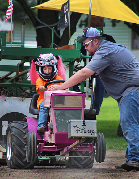Photo by RR Best Garden Tractor Pull The Christian County Tractor Pulling Association held a competition Sunday July 17 in Tabor Park in Sullivan. Kaitlin Morgan from Marshall wheel lifts her Disney puller above during the second annual event at Tabor Park.