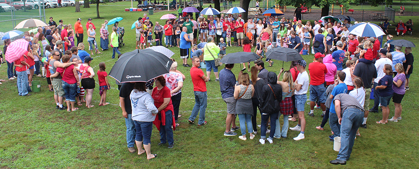 Photo by RR Best Rainy Races Crowds gathered under umbrellas for the 2 p.m. Fourth of July turtle races at Wyman Park in Sullivan. In spite of threatening weather, events continued during the Independence Day celebration. Everything from the parade and games to a fantastic fireworks display sponsored by the Sullivan American Legion Post #68 went off as planned.