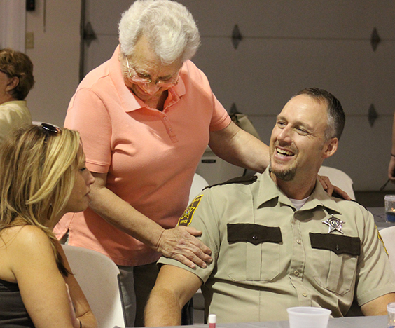 Photo by RR Best Ice Cream Social Thanks  Betty Book expresses her gratitude to Moultrie County deputy Clint Walker at the police and sheriff's department appreciation ice cream social held at the Sullivan V.F.W. Saturday August 27. The 3 p.m. reception sponsored by Citizens of Sullivan gave the public a chance to show their appreciation for what law enforcement does everyday, event coordinator Rob Young explained.