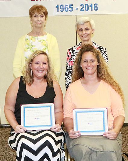 Photo furnished Scholarship Awards from C.E.F.S. Economic Opportunity Corporation recently awarded educational scholarships at their 2016 Annual Board of Directors meeting.  Seated front row (l-r): Jennifer Penberthy and Lynette Green both of Sullivan.  Pictured second row (l-r): CEFS board members Arlene Aschermann and Vickie Bowers.
