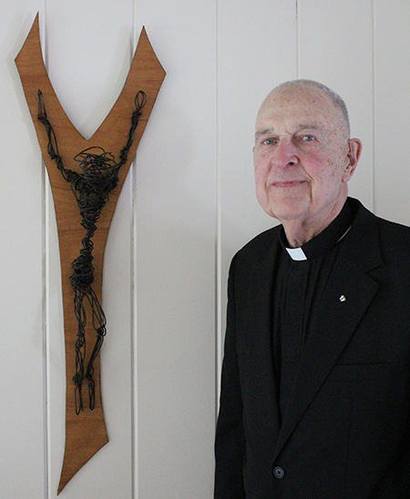 Photo by Mike Brothers Tortured Crucifix Thirty years ago Father Tom Brown of Quincy sculpted the crucifix at Father Sohm's right. Made from hand twisted wire coat hangers Father Brown intended it to represent the torture Jesus underwent on the cross.