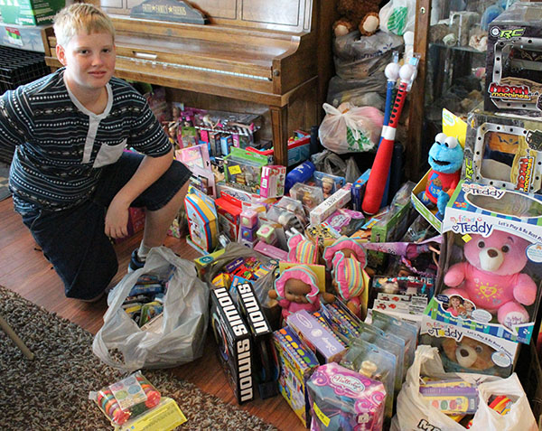 Photo by Bernie Sanders Seth Webner of Bethany isn't letting juvenile rheumatoid arthritis slow him from collecting toys for other patients at Shriner's Hospital in St. Louis. He is collecting more toys from the public at the Sullivan Church of God on Aug. 20.