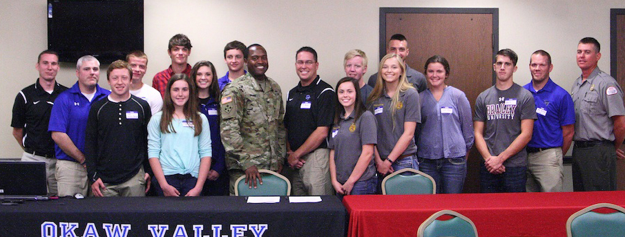 Photo courtesy OVHS Corps of Engineers and Okaw Valley School District recently began a vocational cooperative program on 40 acres of Corps property in Shelby and Moultrie counties. Pictured above are Okaw Valley students, administration and the Corps of Engineers during the agreement's official signing at the Lake Shelbyville headquarters.