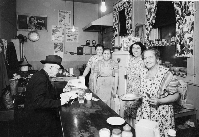 Pictured above is the Blue Front Cafe, which was located on W. Jefferson St. in Sullivan. This photo was taken around the 1940's. The cafe was owned and operated by Albert & Cora Brown. Pictured left to right are: Nola Wren (cook), Mae Harmison, Bernice Reynolds and Cora Brown. John Webb is the customer at counter. Please submit photos to the News Progress for future consideration. Originals will be saved for return or forwarded to Moultrie County Historical Society. If you have any other information, please contact the Moultrie County Historical Society at 217-728- 4085.