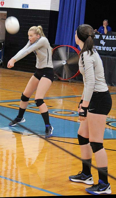 Photo by Mike Brothers Kristy Burford sets up return with Kate Jeffers in Okaw Valley volleyball match with Arcola Sept. 22 in Bethany.