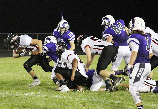 Photo by Mike Brothers It was tough making ground but Luke Bowman leaves Shelbyville's defense plowing through for a modest gain.