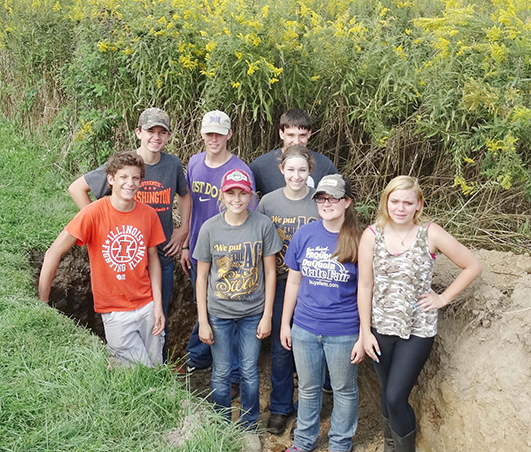 Photo furnished  ALAH FFA members took to the pits at the Section 17 Land Use CDE. Pictured are: (front) Griffin Rose, Makenna Green, Katie Gingerich, and Veronica Chambers; (middle) Taylor Powell, and (back) Adam Hingson, Adam Day, and Koby Stutzman.