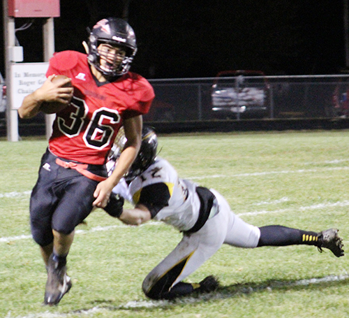 Photo by Mike Brothers Redskins running back Luke Bowman turns the corner and gains a few yards in SOV's season ending game with Tuscola Oct. 21.