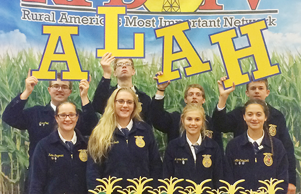Photo furnished The ALAH FFA members pose in front of the RFD-TV backdrop. First Row (L-R) Katie Gingerich, Bri Smith, Makenna Green, and Janette Comstock. Back Row (L to R) Zane Crist, Colton Romine, Adam Day and Adam Hingson.