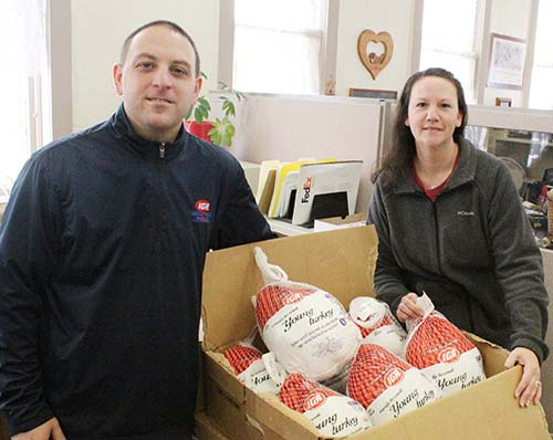 Food Pantry Thanksgiving Turkeys arrived from Sullivan IGA just in time for Thanksgiving at the Moulrie County Food Pantry. Above IGA manager Pat Stinson and pantry coordinator Kristy Dawson prepare turkeys for delivery.