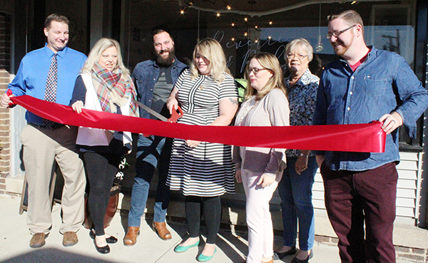 Photo by Mike Brothers Reverie and Rule Sullivan Chamber representatives gathered at the November 4 ribbon cutting ceremony for Reverie and Rule in downtown Sullivan. Pictured from left: City Clerk Monte Johnson, Chamber president Cathrine Craig, Reverie & Rule owners Brett and Chelsea Beery, Hollie Atchison, Lori Harbaugh, and John Stephens. Reverie and Rule offers specialty gifts, stationary and gift cards.