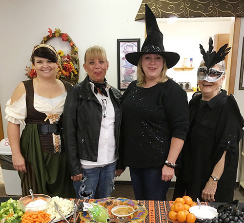 Photo by Ellen Ferrera Senior Center staff Alicia Moyer(l),Vonnie Lee, Kathi Shackles and Mary Flint preside over a groaning treat table!