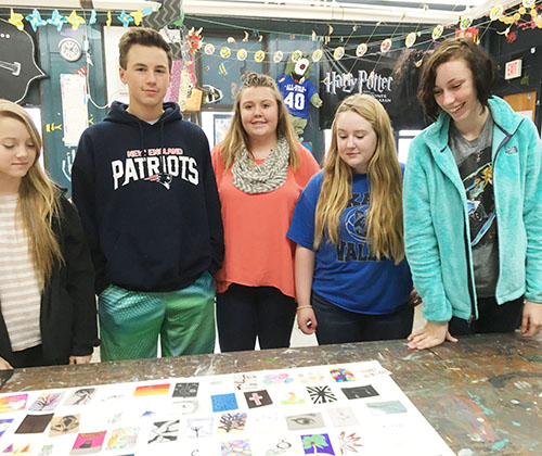 Photo by Ellen Ferrera-Dick OVHS students Destiny Underwood, Cameron Nickerson, Savannah Gibbons, Kelly McGill and Chloe Wirey check out the trading cards that will help them contact students from around the world and around the area.