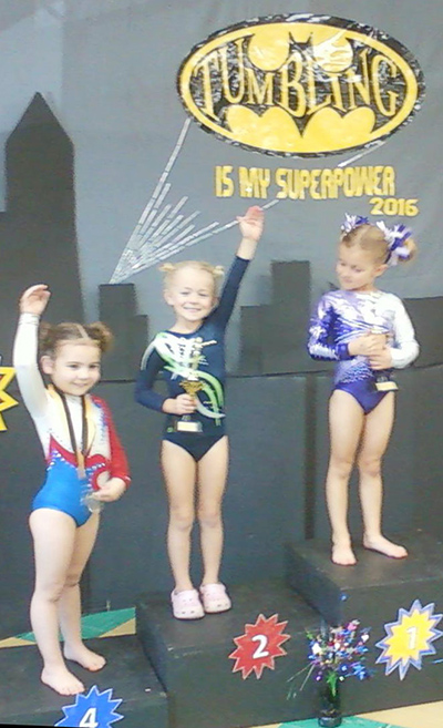 Photo furnished Tumbling Champs Sylvia Dawkins, 5, of Sullivan, pictured second from left, earned second place finish in her first tumbling meet last weekend.