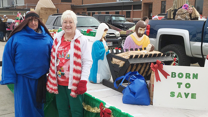 Photo by Ellen Ferrera Christmas Parade veterans Mary Ellison (shepherd) and Nancy Vail on parade day.