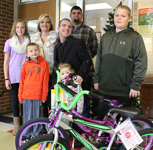 Photo by Mike Brothers Bicycle Gifts for Lovington Kids: Two bicycles were given to two Lovington elementary students Dec. 21. One boy and one girl student were selected randomly from all students enrolled. Pictured above: Winner Layna Kapp, Amanda Scroggins with son Lincoln in front, Joc French with daughter Kenzie Frye in front, winner Hunter Carnahan, and Sebastian Eckart (back). The French family has presented gift bicycles for more than 25 years, a tradition begun by Joc's parents Mark and Tammy French.