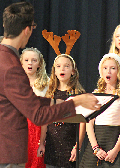 Photo by RR Best Holiday Concert Sullivan Middle School was the scene of the holiday concert held this past weekend. Mr. Jeff Thomas and Mr. Brock Freece coordinated the school wide musical event played to a capacity crowd. Above Thomas leads: (left to right) Molly Dendy, Natalee Hunter, and Rylee Roehrs sing a special holiday tune.