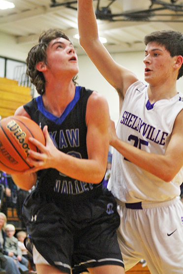 Photo by RR Best Under Pressure Timberwolves Connor Cloyd is under pressure from Shelbyville defender during the 55-32 Okaw Valley High School loss to Shelbyville December 2.