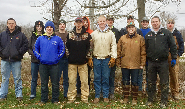 Photo furnished The Okaw Valley High School U.S. Corp of Engineers Cooperative continued last week as students planted trees as part of the environmental restoration phase. Back row left to right: Brody Bland, AnthonyWeekly, Zared Ledbetter, Matthew Buxton, Conner Cloyd, J.T. Bland, and Tanner Coleman. Front row left to right: Cody Hinkle, Cody Drake, Ethan Macklin, Jesse Robinson, Wes Wise