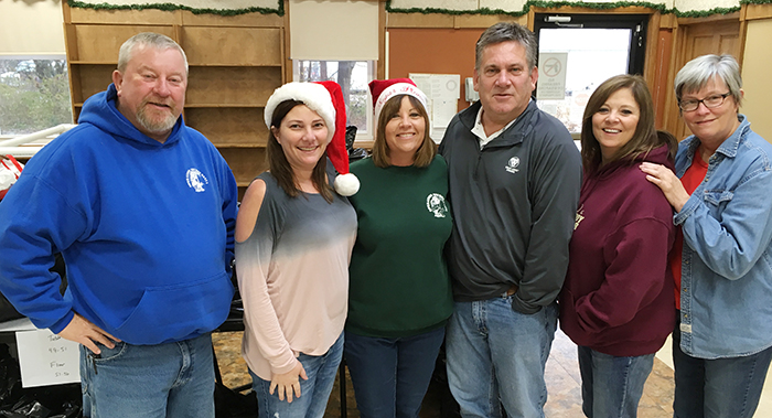 Photo furnished Secret Santa Volunteers Secret Santa volunteers from pickup day are Gregg Foster, Lisa Sheehan, Justine Brewer, Mark Brewer, Carol Mode and Cheryl Thomas. These are just a few of the volunteers with Secret Santa. The volunteers say they are blessed to be able to give back to the communities of Moultrie County.