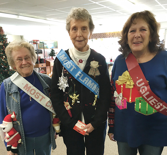 Photo by Ellen Ferrera Above are winners of the ugly sweater contest. Pictured left to right are Peggy Booker (most creative), Shirley Devore (most flammable), and Pam Mann (overall ugliest).