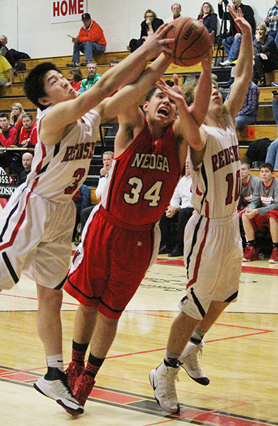 Photo by Darian Hays Sullivan Redskins Ricky Yang and Queintan Britton fight for a rebound during the home game against Neoga Dec. 9.